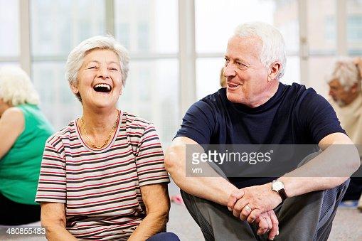 Seniors Enjoying Conversation In Community Center