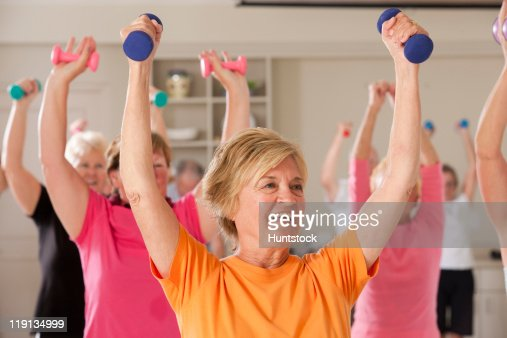Seniors exercising with dumbbells in a health club : Foto stock