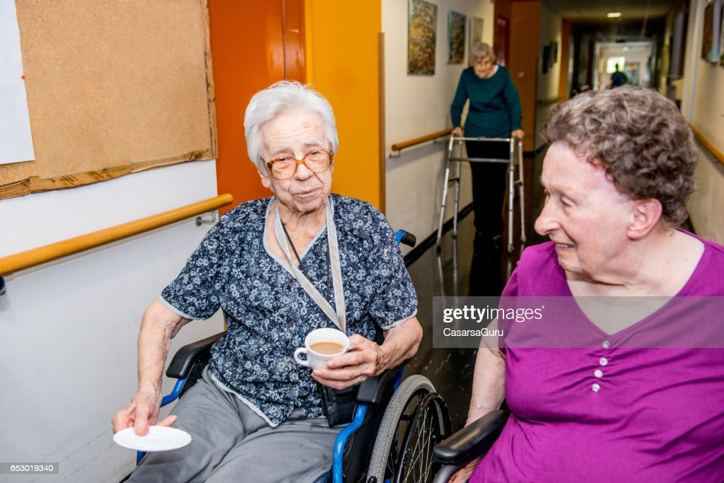 Seniors Having Break In The Retirement Home : Stock Photo