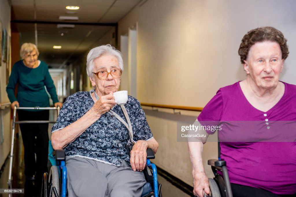 Seniors Having Break In The Retirement Home : Stock-Foto
