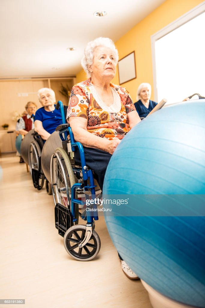 Seniors Having Physical Therapy In The Retirement Home : Photo