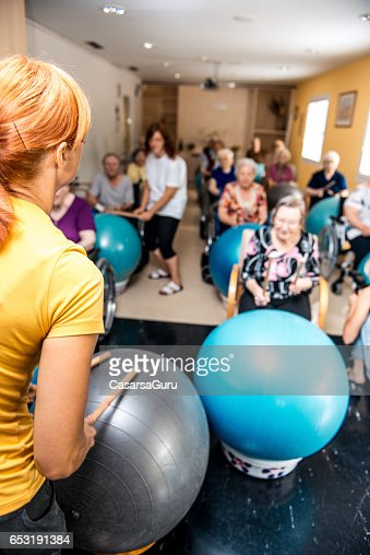Seniors Having Physical Therapy In The Retirement Home : Stock Photo