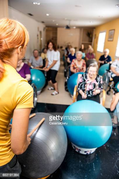 Seniors Having Physical Therapy In The Retirement Home