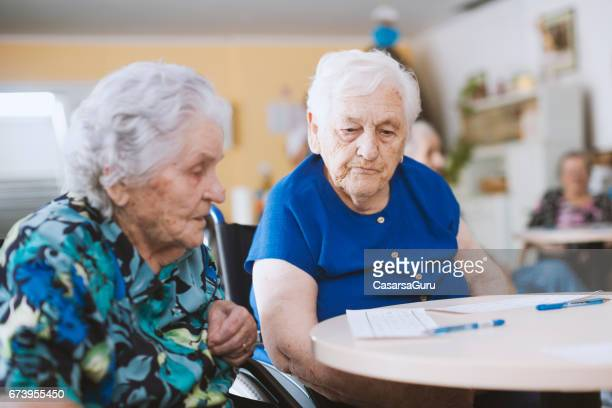 Seniors In The Nursing Home Playing Bingo For Relaxation