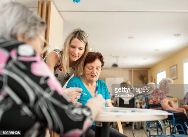 Seniors In The Retirement Community Spending Playing Bingo