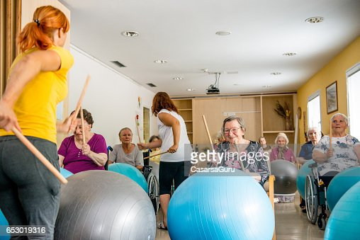 Seniors In The Retirement Home Having Group Therapy : Photo