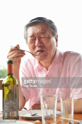 A senior's man is eating a lunch. : Stock Photo