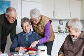 Seniors of a flat-sharing community using digital tablet