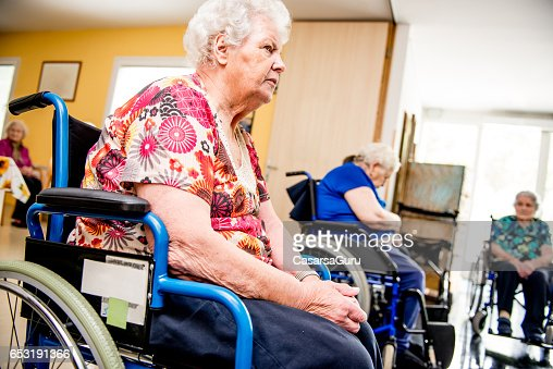 Seniors On The Wheelchair Attend In The Retirement Home : Stock-Foto