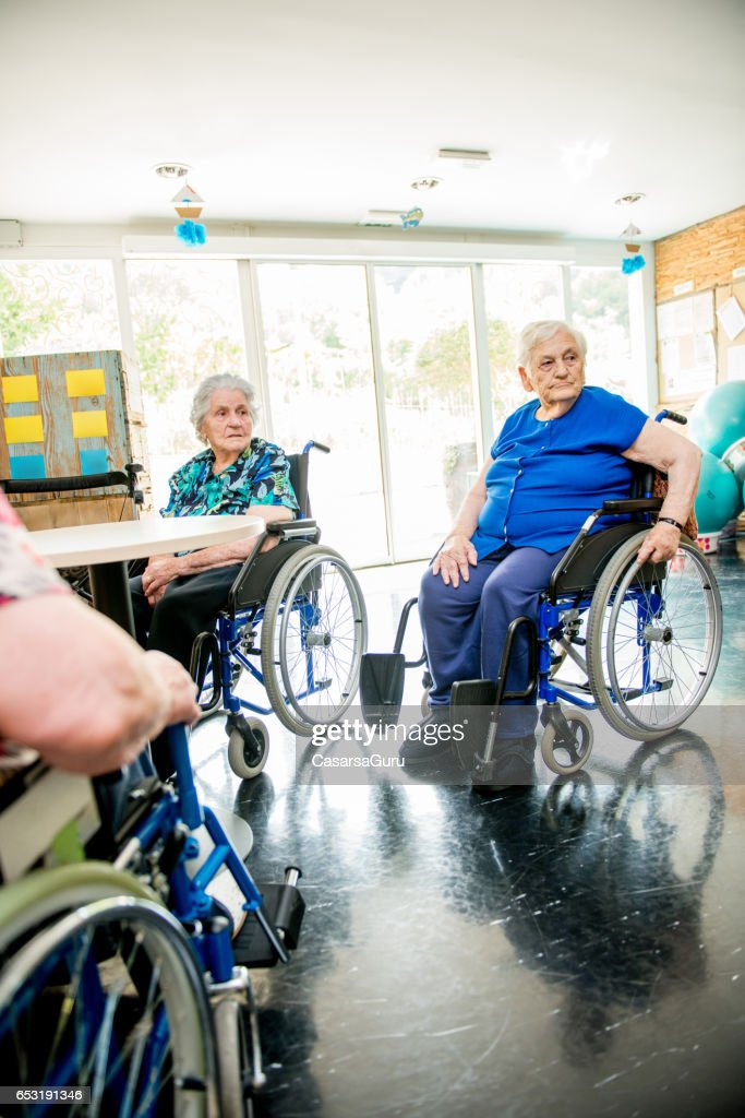 Seniors On The Wheelchair In The Nursing Home Waiting For The Therapy In The Gym Class : Bildbanksbilder