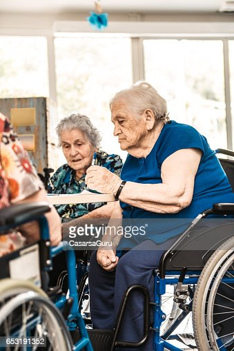 Seniors On The Wheelchair In The Nursing Home Waiting For The Therapy In The Gym Class : ストックフォト