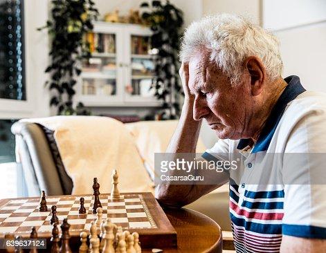 Seniors Playing Chess : Stock Photo