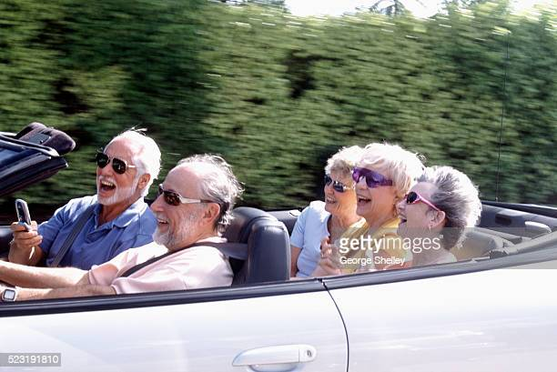 Seniors Riding in Convertible