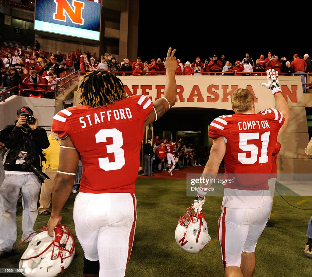 Seniors safety Daimion Stafford #3 and linebacker Will Compton #51 of the Nebraska Cornhuskers leave the Memorial Stadium field after their game against the Minnesota Golden Gophers at Memorial Stadium on November 17, 2012 in Lincoln, Nebraska. Nebraska won 38-14.