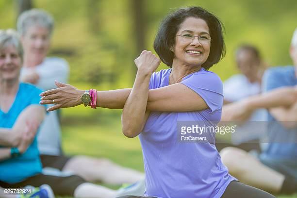 Seniors Taking an Outdoor Fitness Class