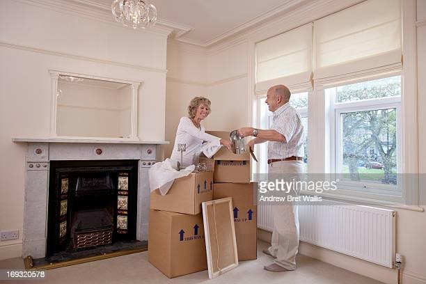 Seniors unpack in a newly refurbished room
