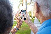 Seniors using digital device