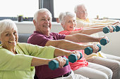 Seniors using weights in a retirement home