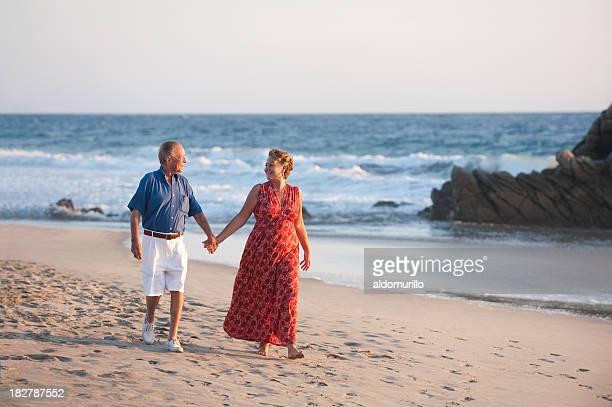 Seniors walking by the beach