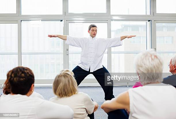 Seniors Watching Tai Chi Exercises