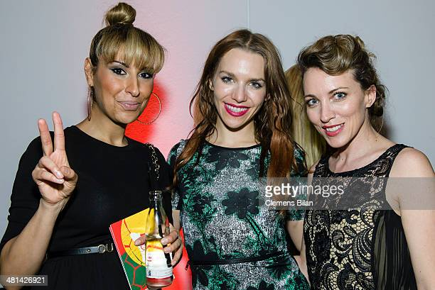 Senna Gammour Julia Dietze and Sanny van Heteren pose at the Gala Night of the FIFA World Cup Trophy Tour on March 29 2014 in Berlin Germany