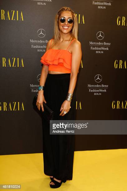 Senna Guemmour arrives for the Opening Night by Grazia fashion show during the MercedesBenz Fashion Week Spring/Summer 2015 at Erika Hess Eisstadion...