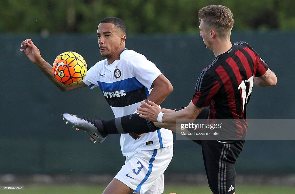 Senna Miangue of FC Internazionale competes for the ball with Luca Vido of AC Milan during the juvenile match between AC Milan and FC Internazionale at Centro Sportivo Giuriati on April 29, 2016 in Milan, Italy.