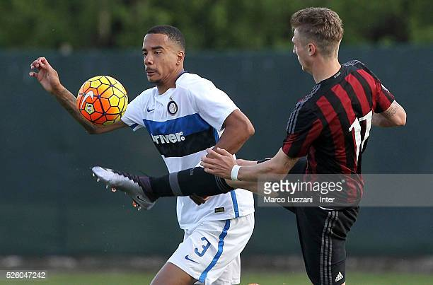 Senna Miangue of FC Internazionale competes for the ball with Luca Vido of AC Milan during the juvenile match between AC Milan and FC Internazionale...