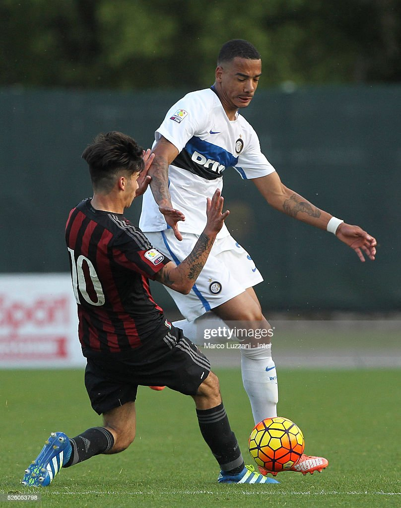 Senna Miangue (R) of FC Internazionale competes for the ball with Giovanni Crociata (L) of AC Milan during the juvenile match between AC Milan and FC Internazionale at Centro Sportivo Giuriati on April 29, 2016 in Milan, Italy.