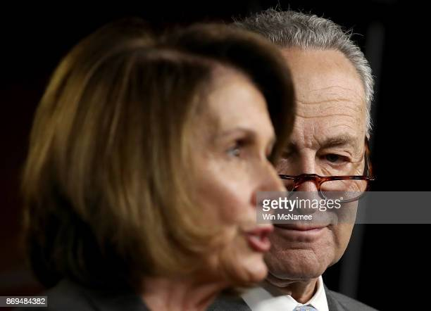 Sennate Minority Leader Chuck Schumer listens as House Minority Leader Nancy Pelosi speaks during a press conference where congressional Democrats...