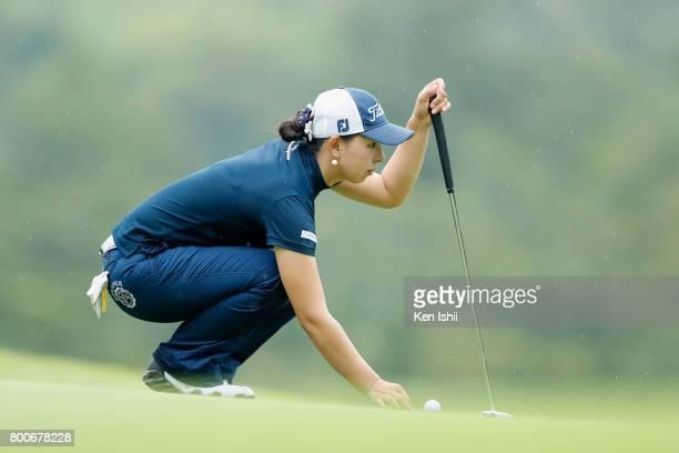 Senno Yasufuku of Japan lines up on the 9th green during the final round of the Yupiteru The Shizuoka Shimbun SBS Ladies at the Shizuoka Country...