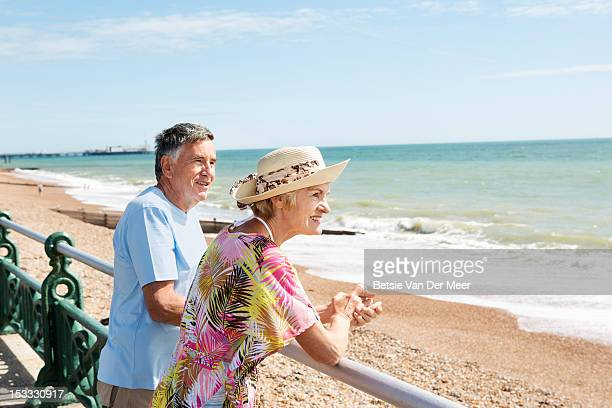 Senoir couple looking out over sea.