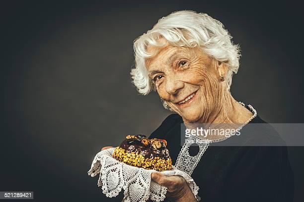Senoir lady holding cake