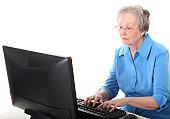 senor woman using a computer