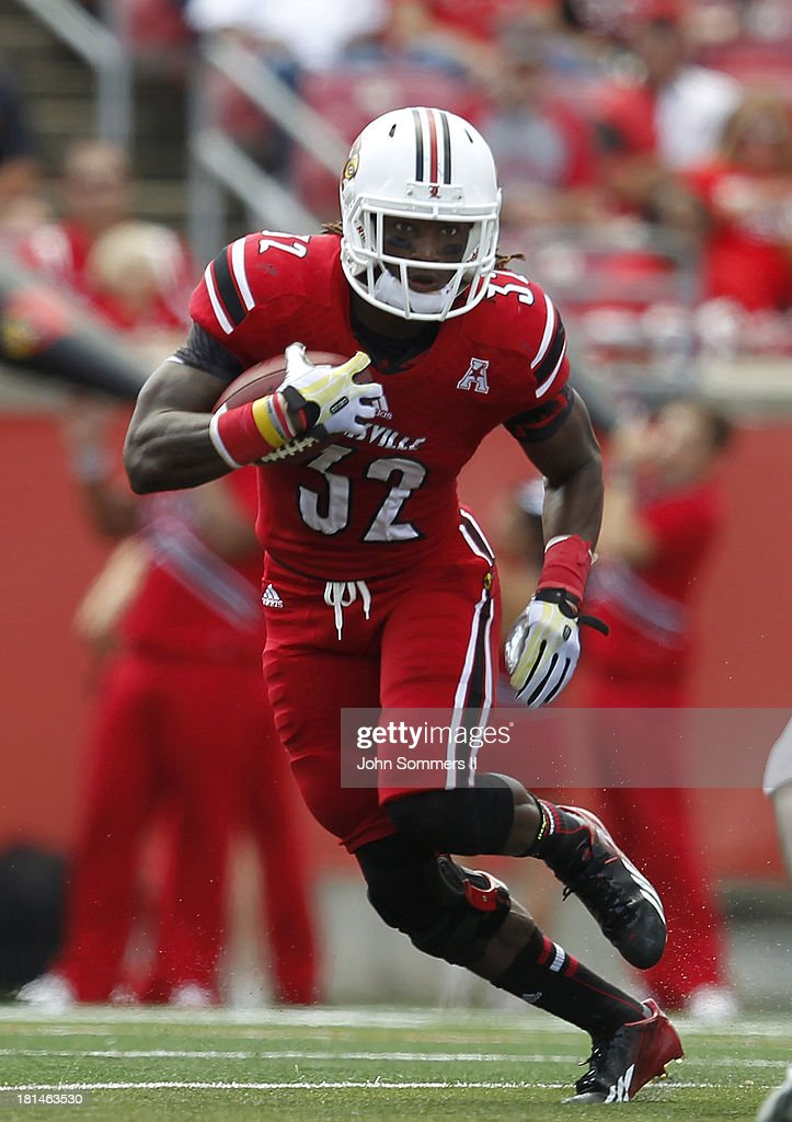 Senorise Perry #32 of the Louisville Cardinals runs the ball during their game against the Florida International Panthers at Papa John's Cardinal Stadium on September 21, 2013 in Louisville, Kentucky.