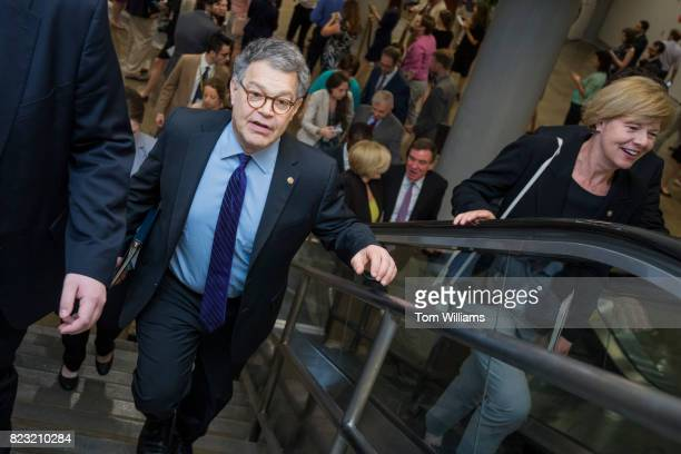 Sens Al Franken DMinn and Tammy Baldwin DWis are seen in the senate subway before a series of votes in the Capitol related to the healthcare plan on...