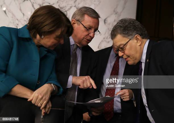 US Sens Amy Klobuchar Dick Durbin and Al Franken huddle during the third day Judge Neil Gorsuch's Supreme Court confirmation hearing before the...