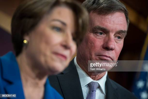Sens Amy Klobuchar DMinn and Mark Warner DVa conduct a news conference in the Capitol on the Honest Ads Act which aims to make online political ads...
