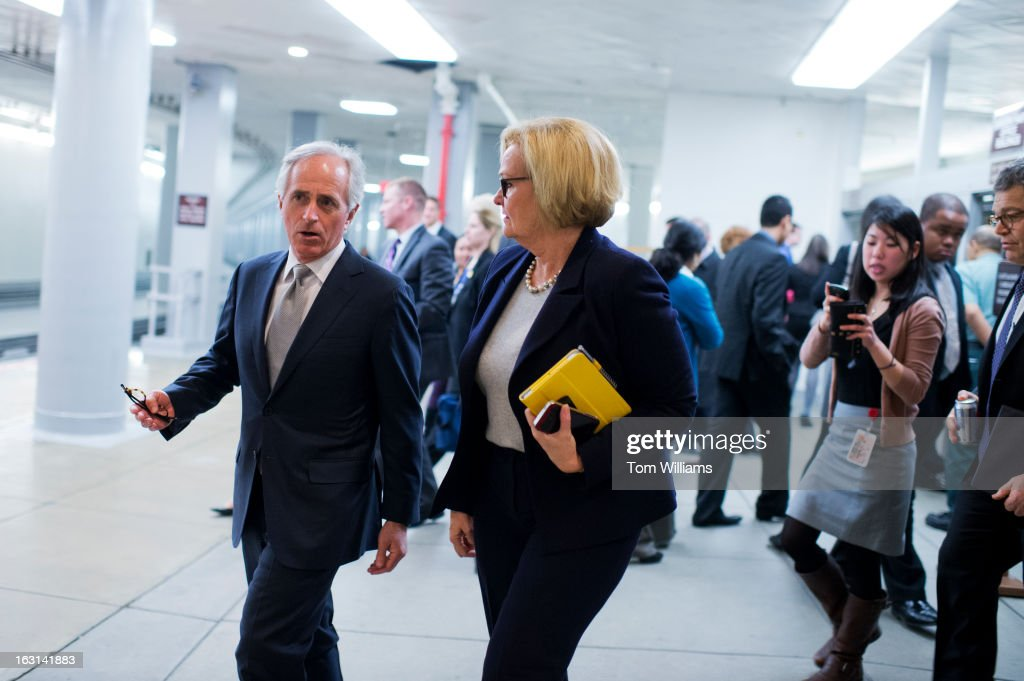 Sens. Bob Corker, R-Tenn., and Claire McCaskill, D-Mo., make their way through the senate subway en route to a vote before the senate luncheons in the Capitol.