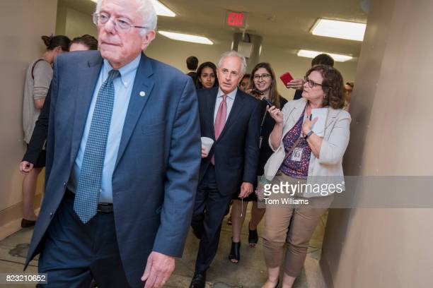 Sens Bob Corker RTenn right and Bernie Sanders IVt talk with reporters in the senate subway before a series of votes in the Capitol related to the...