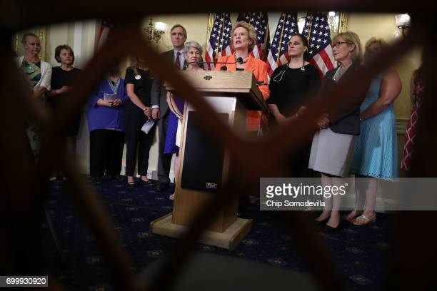 S Sens Debbie Stabenow Jeff Merkley and Maggie Hassan hold a news conference with nurses and nurse practicioners at the US Capitol June 22 2017 in...