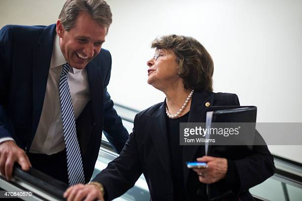 Sens Dianne Feinstein DCalif and Jeff Flake RAriz talk in the Capitol's senate subway after the Senate voted to confirm Loretta Lynch as attorney...