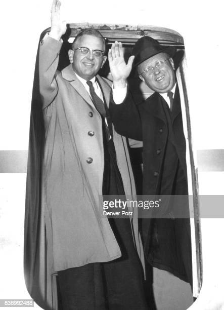 Sens Gordon Allott of Colorado and Frank Barrett of Wyoming are framed in doorway of plane as they arrive at Stapleton airfield after trip to Bangkok...