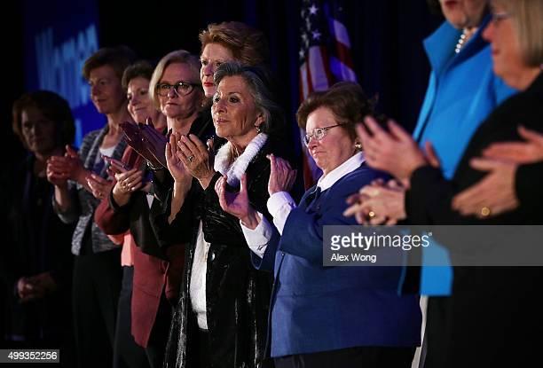 US Sens Heidi Heitkamp Tammy Baldwin Jeanne Shaheen Claire McCaskill Debbie Stabenow Barbara Boxer Barbara Mikulski applaud during a 'Women for...