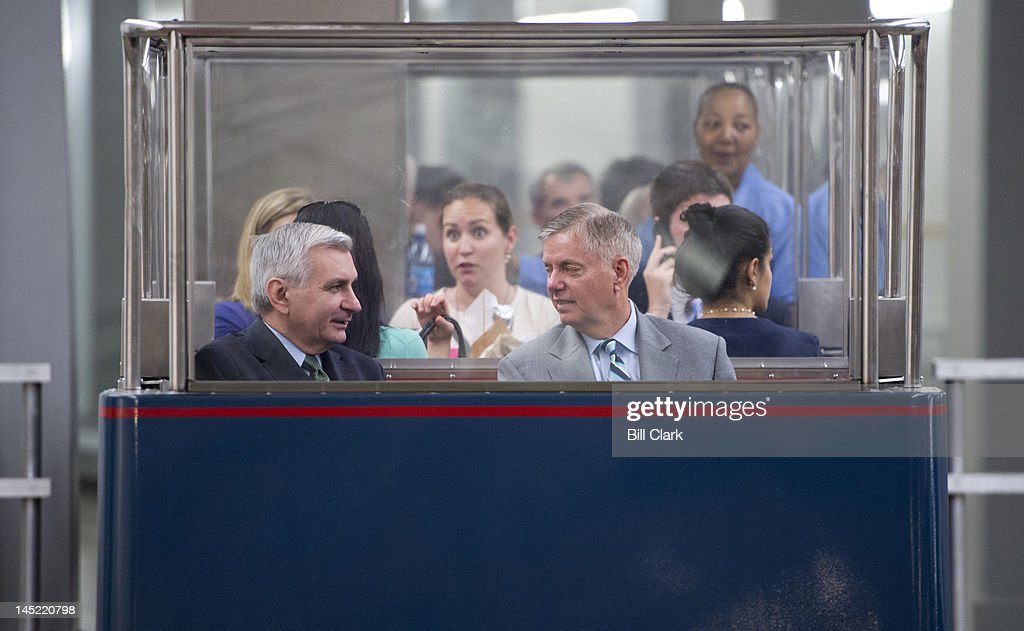Sens. Jack Reed, D-R.I., left, and Lindsey Graham, R-S.C., arrive in the Capitol via the Senate subway for votes on the Food and Drug Administration reauthorization bill on Thursday, May 24, 2012.