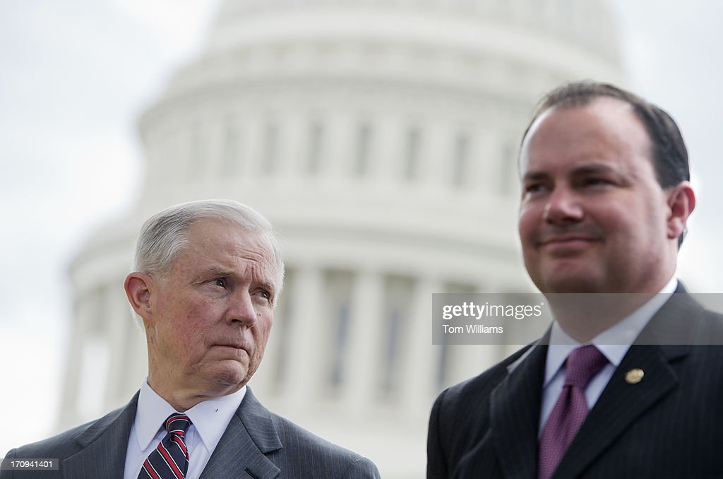 Sens. Jeff Sessions, R-Ala., left, and Mike Lee, R-Utah, attend a news conference outside of the Capitol to oppose the immigration reform bill in the Senate.