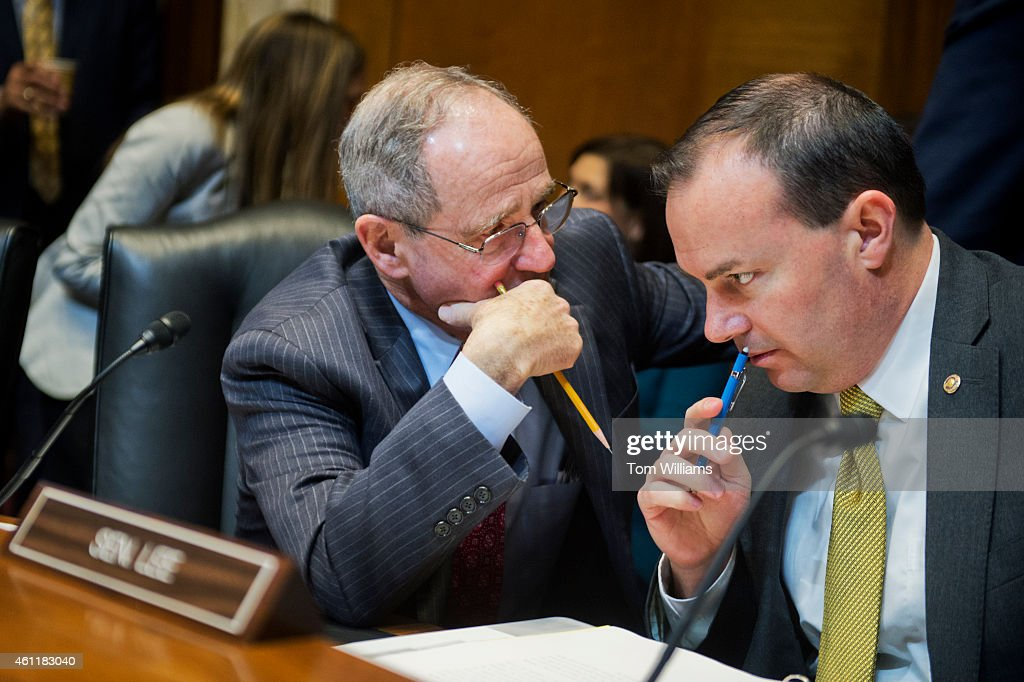 Sens. <a gi-track='captionPersonalityLinkClicked' href=/galleries/search?phrase=Jim+Risch&family=editorial&specificpeople=5610137 ng-click='$event.stopPropagation()'>Jim Risch</a>, R-Idaho, left, and Mike Lee, R-Utah, confer before a Senate Energy and Natural Resources Committee markup in Dirksen Building on legislation to approve the Keystone XL pipeline, January 8, 2015.