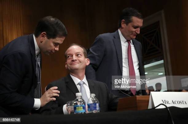 S Sens Marco Rubio and Ted Cruz depart following their introductions of Labor Secretary nominee Alexander Acosta prior to Acosta's testimony before...