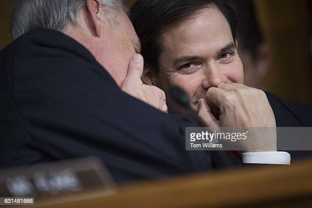 Sens Marco Rubio RFla right and Ron Johnson RWis talk during the Senate Foreign Relations Committee confirmation hearing for Secretary of State...