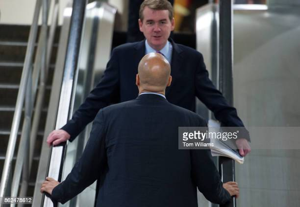Sens Michael Bennet DColo background and Cory Booker DNJ are seen in the basement of the Capitol after the Senate Policy luncheons on October 17 2017